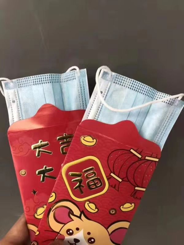 An image of red envelopes filled by surgical masks