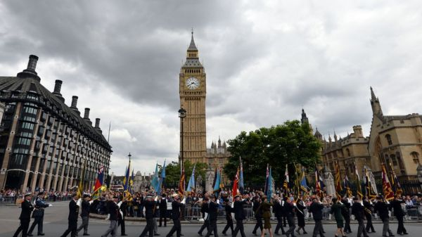 Flag bearers pass through Parliament Square as they take part in a parade from Horse Guards Parade to Westminster Abbey after a service of commemoration during the 70th Anniversary commemorations of VJ Day (Victory over Japan) on August 15, 2015 in London, England.