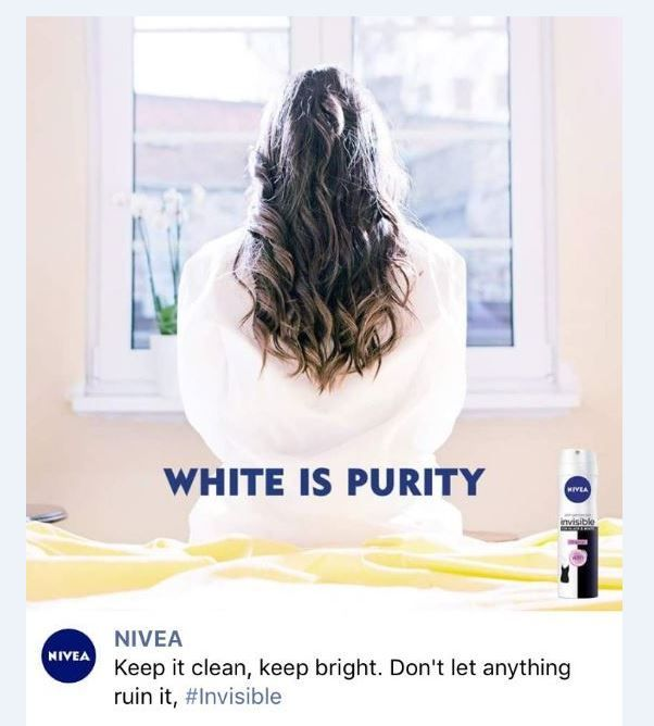 a screenshot of the advert: a woman is pictured back to camera in a white robe with the words 'white is purity' and an image of the can.