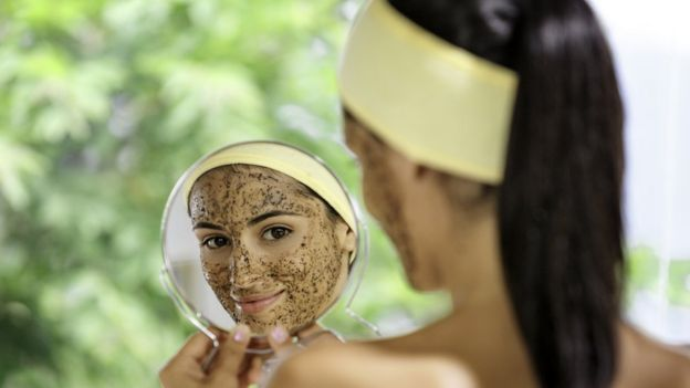 A woman with facial scrub on