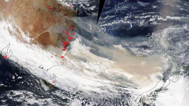 A Nasa satellite image shows smoke plumes off Australia's east coast on 5 January travelling towards New Zealand