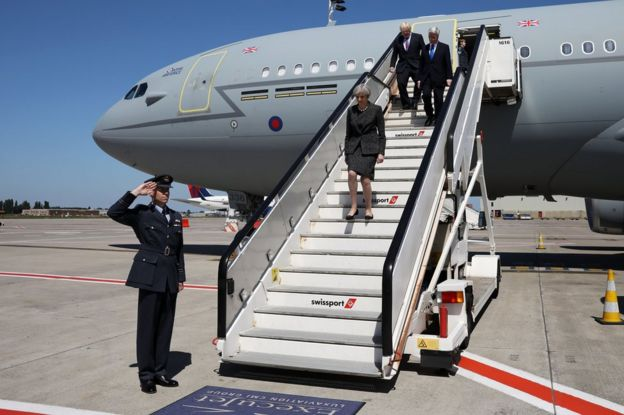 UK Prime Minister Theresa May, flanked by Foreign Secretary Boris Johnson and Defence Secretary Sir Michael Fallon, arrive in Brussels, 25 May