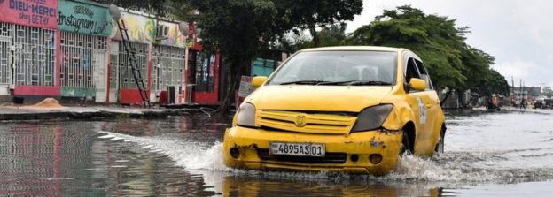 Car driving through water