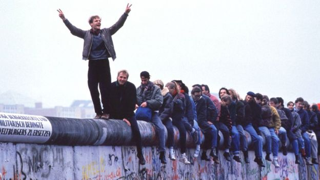 West Germans celebrate the collapse of communism atop the Berlin Wall, 12 November 1989