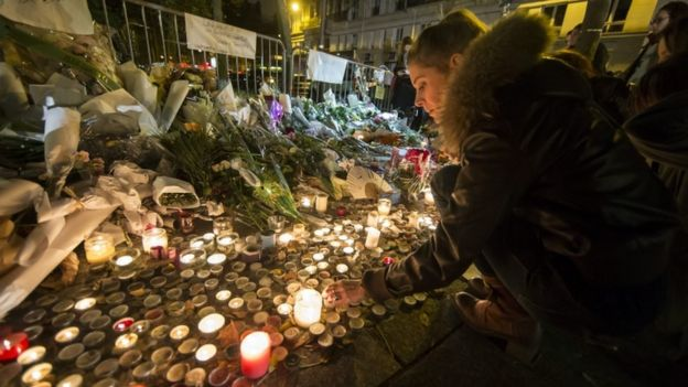 Flowers and candles laid in tribute near the Bataclan concert venue in Paris