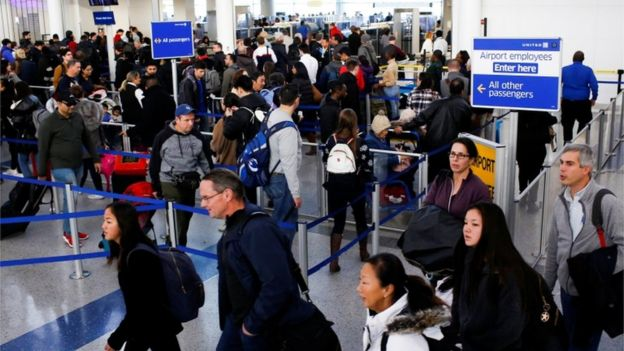 Travelers arrive for TSA inspection as they make their way through Newark Liberty International Airport in Newark, New Jersey
