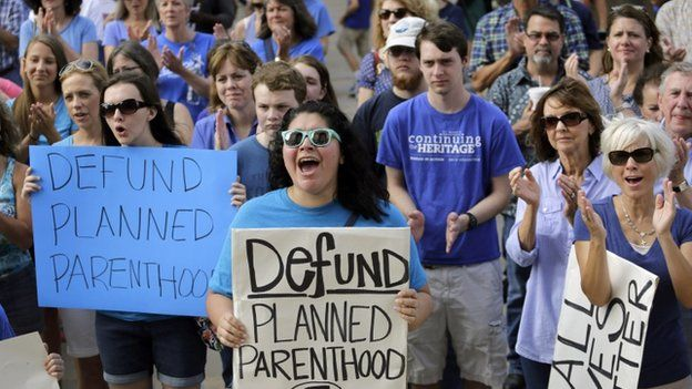 In this July 28, 2015, file photo, Erica Canaut, center, cheers as she and other anti-abortion activists rally on the steps of the Texas Capitol in Austin, Texas,