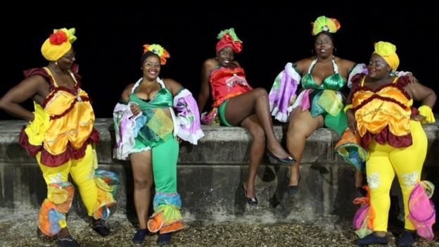 Revellers on Havana's Malecon seafront before performing at a carnival parade (12 August 2016)
