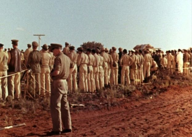 Troops turn their backs on a nuclear test at Maralinga, in South Australia