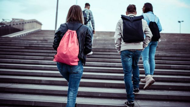 Students walking up a staircase