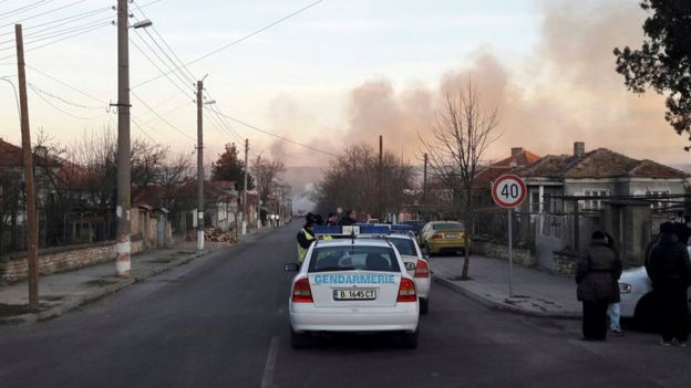 Smoke rises after a cargo train derailed and exploded in the village of Hitrino, Bulgaria, December 10, 2016.