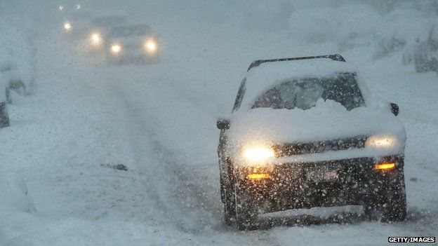 Cars driving in snowstorm