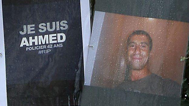 Tributes to Ahmed Merabet near where he was gunned down on Boulevard Richard Lenoir in Paris, 7 January 2015
