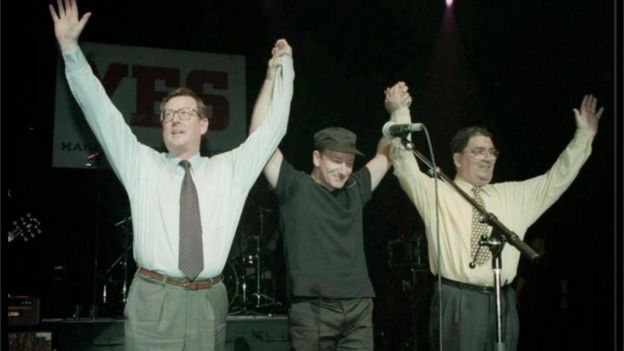 Ulster Unionist leader David Trimble (left), U2 singer Bono, and SDLP leader John Hume on stage for the YES concert at the Waterfront Hall in Belfast in 1998