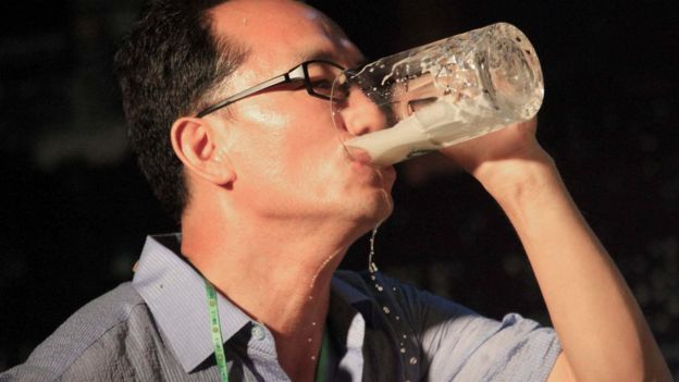 A North Korean man gulps down a glass of draft beer during a beer drinking competition held on Friday, Aug. 12, 2016 in Pyongyang, North Korea. This competition was held during a beer festival along the Taedong River in the North Korean capital.