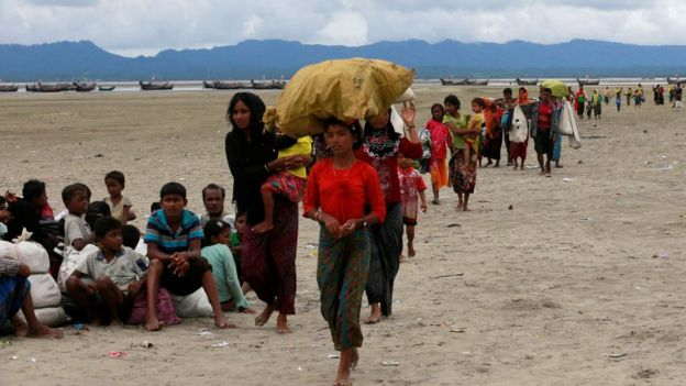 Rohingya refugees walk to a Border Guard Bangladesh (BGB) post after crossing the Bangladesh-Myanmar border by boat through the Bay of Bengal in Shah Porir Dwip, Bangladesh, 10 September 2017