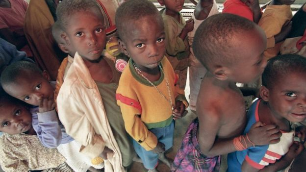 Orphan Rwandan children line up for food on July 17, 1994, at the old French school in Kigali