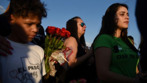 People gather to pay their respects at a growing memorial three days after a mass shooting at a Walmart store in El Paso, Texas, US, August 6, 2019