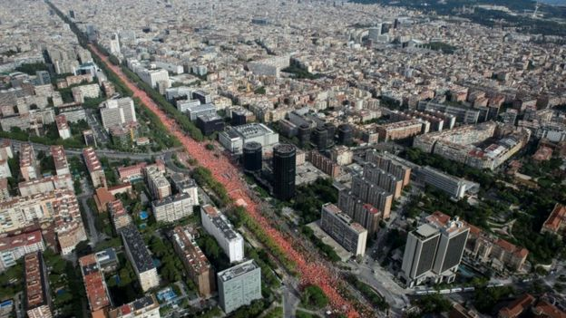 A line of red shirts in central Barcelona