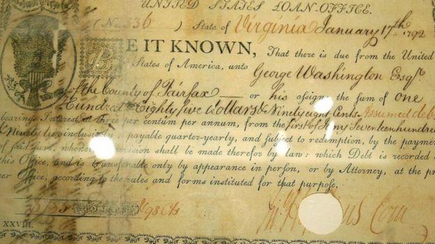 Primeiro uso do símbolo do dólar em um documento financeiro americano, assinado pelo ex-presidente dos EUA George Washington em 1792