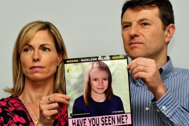 Gerry and Kate McCann at a press conference in London where they hold an image of what Madeline might look like as an older girl
