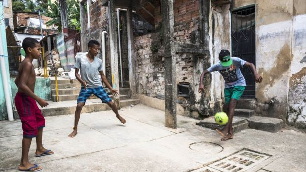 Boys playing football on the streets of Salvador