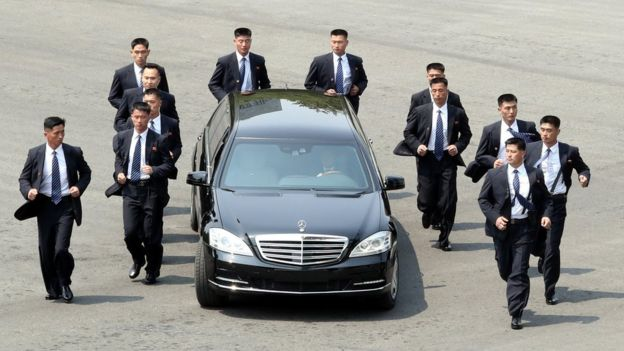 Kim Jong-un's Mercedes car flanked by bodyguards at the Inter-Korean summit