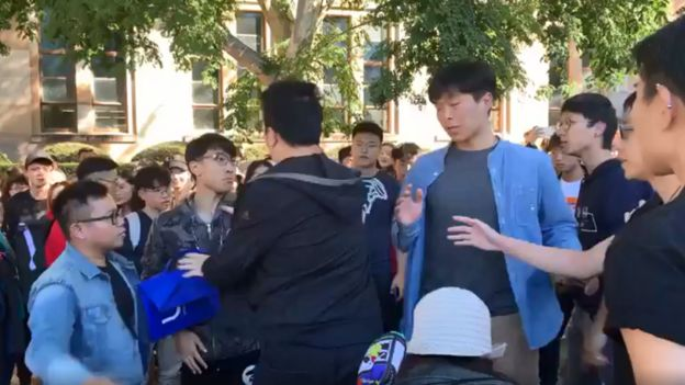 A screenshot of a video which shows one student hitting another during the 24 July protest