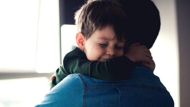 Child hugging his dad