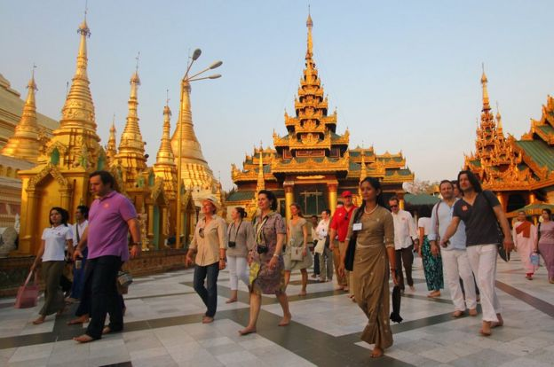 Tourists walking around the Shwedagon pagoda in Yangon, Myanmar