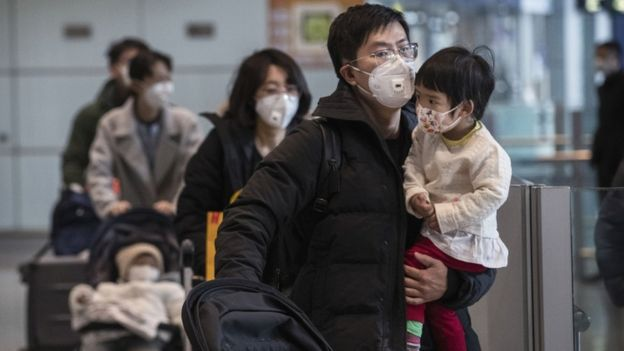 Passengers wear protective masks in Beijing Capital Airport on January 30, 2020