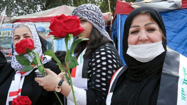Mujeres con rosas
