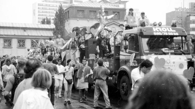 Festival-goers party in the streets of Berlin and on top of a truck at Love Parade 1992