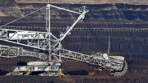 A coal dredger tears coal from the face of the Loy Yang Open Cut coal mine in the Latrobe Valley, Australia