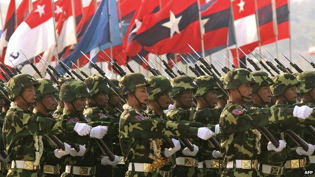 Myanmar soldiers parade during ceremonies marking Armed Forces Day in Naypyidaw on 27 March 2007.
