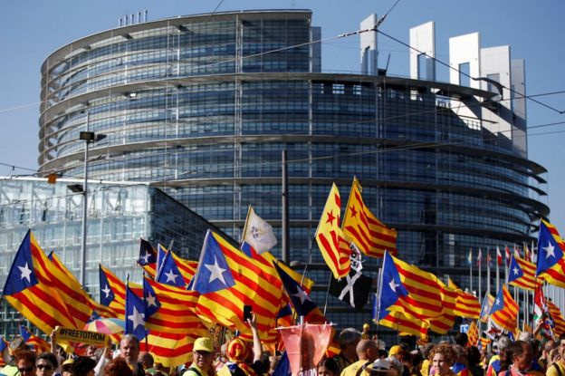 """Catalan pro-independence """"Estelada"""" flags and banners during a demonstration at the European Parliament on July 2 , 2019"""