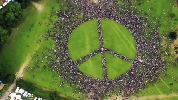The symbol of peace made by and with people in Glastonbury.