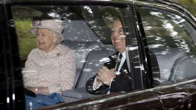 The Queen and Prince Andrew arrive in a car