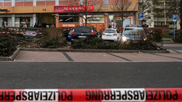 Police barrier tape flutters in front of the Arena shisha bar, one of two crime scenes after two shootings in Hanau
