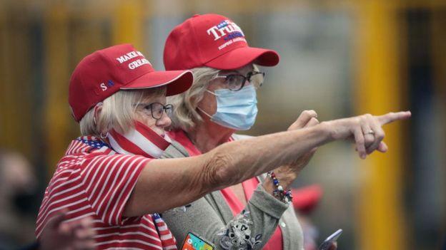 Two female Trump voters in campaign attire