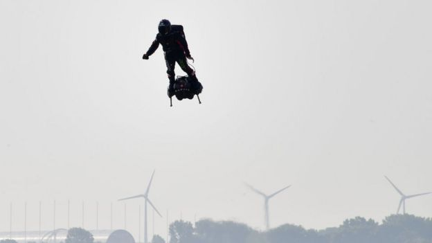 Franky Zapata stands on his jet-powered flyboard as he takes off