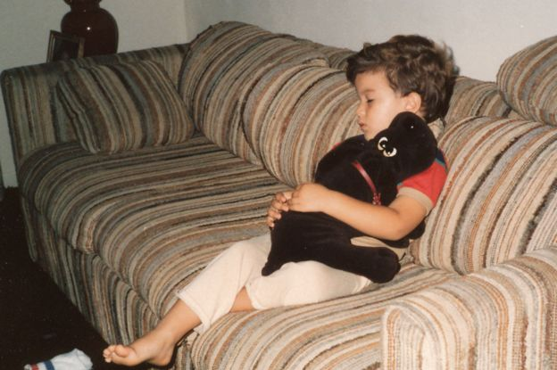 Salinas as a child, sleeping on a sofa