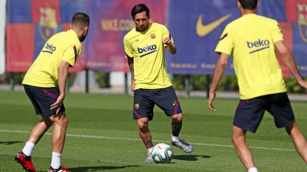 Lionel Messi of FC Barcelona controls the ball during a training session