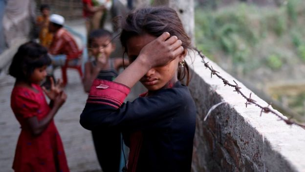 A Rohingya refugee girl wipes her eyes as she cries at Leda Unregistered Refugee Camp in Teknaf, Bangladesh, February 15, 2017