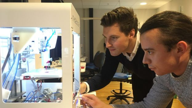Cellink boss Erik Gatenholm (left) and a member of staff checking on a 3D printer