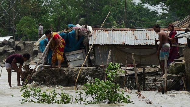 People try and fix their damaged homes in Khulna, Bangladesh after Cyclone Fani hit on May 4