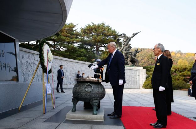 U.S. President Donald Trump burns incense at the National Cemetery on November 8, 2017 in Seoul, South Korea. Trump is in South Korea as a part of his Asian tour. (Photo by Jeon Heon-Kyun-Pool/Getty Images)