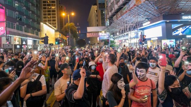 Protesters hold up mobile phone torches during an anti-government protest in Hong Kong, on 27 October, 2019