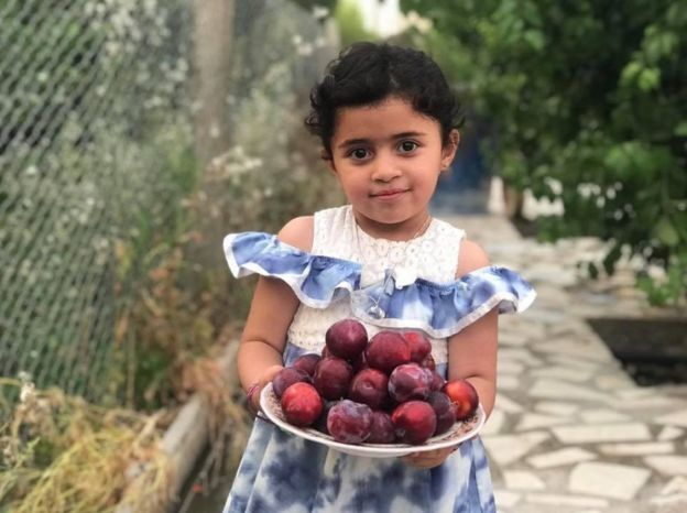Girl with plums