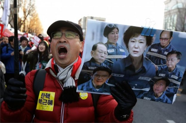 A protester shouts slogans against South Korean President Park Geun-Hye on December 10, 2016 in Seoul, South Korea.